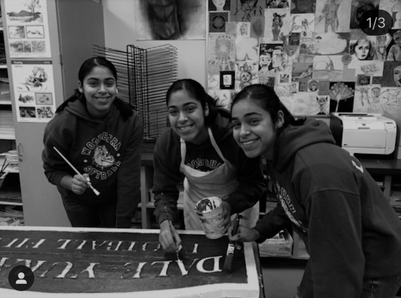 Students painting a sign