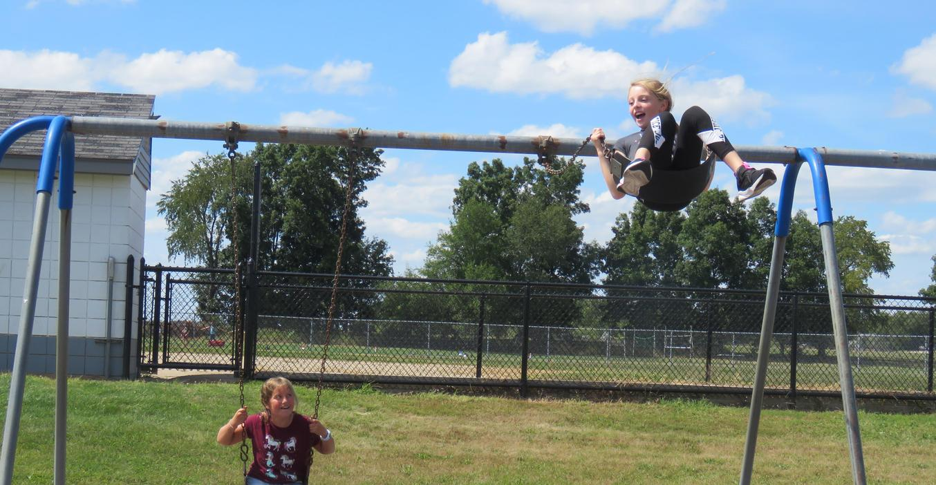 Page students enjoy the swings at recess.