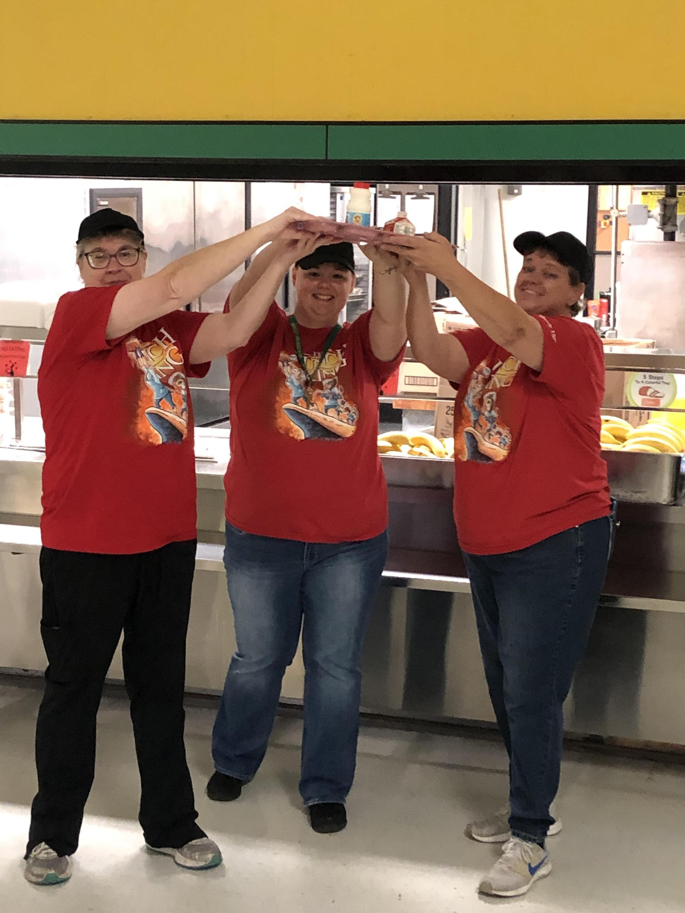 Cafeteria ladies having fun