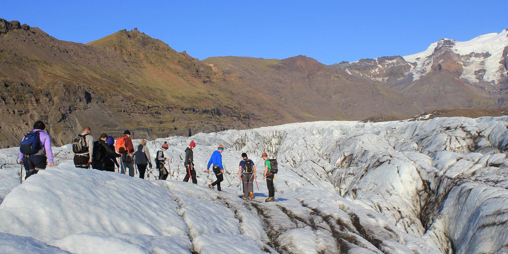 Students walking on a glacier on the Field Course in Iceland.