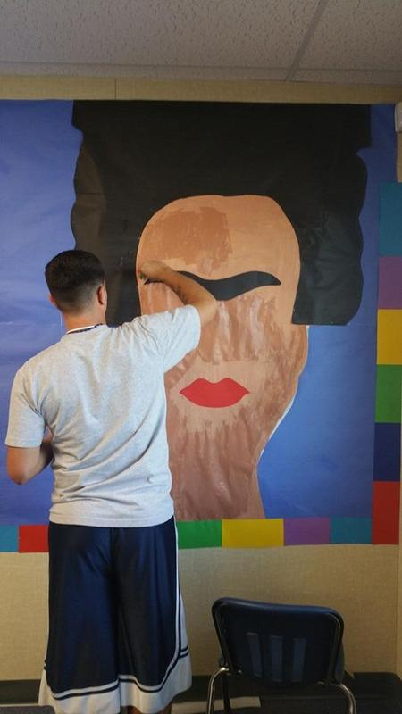 Student completing painting