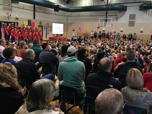 Assembly of patrons gathered to honor veterans