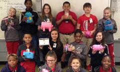 Ms. Williams's fifth grade science class at Port Barre Middle School recycled trash found in their home. They created a new item having a completely new function from the items collected.  They did a great job!