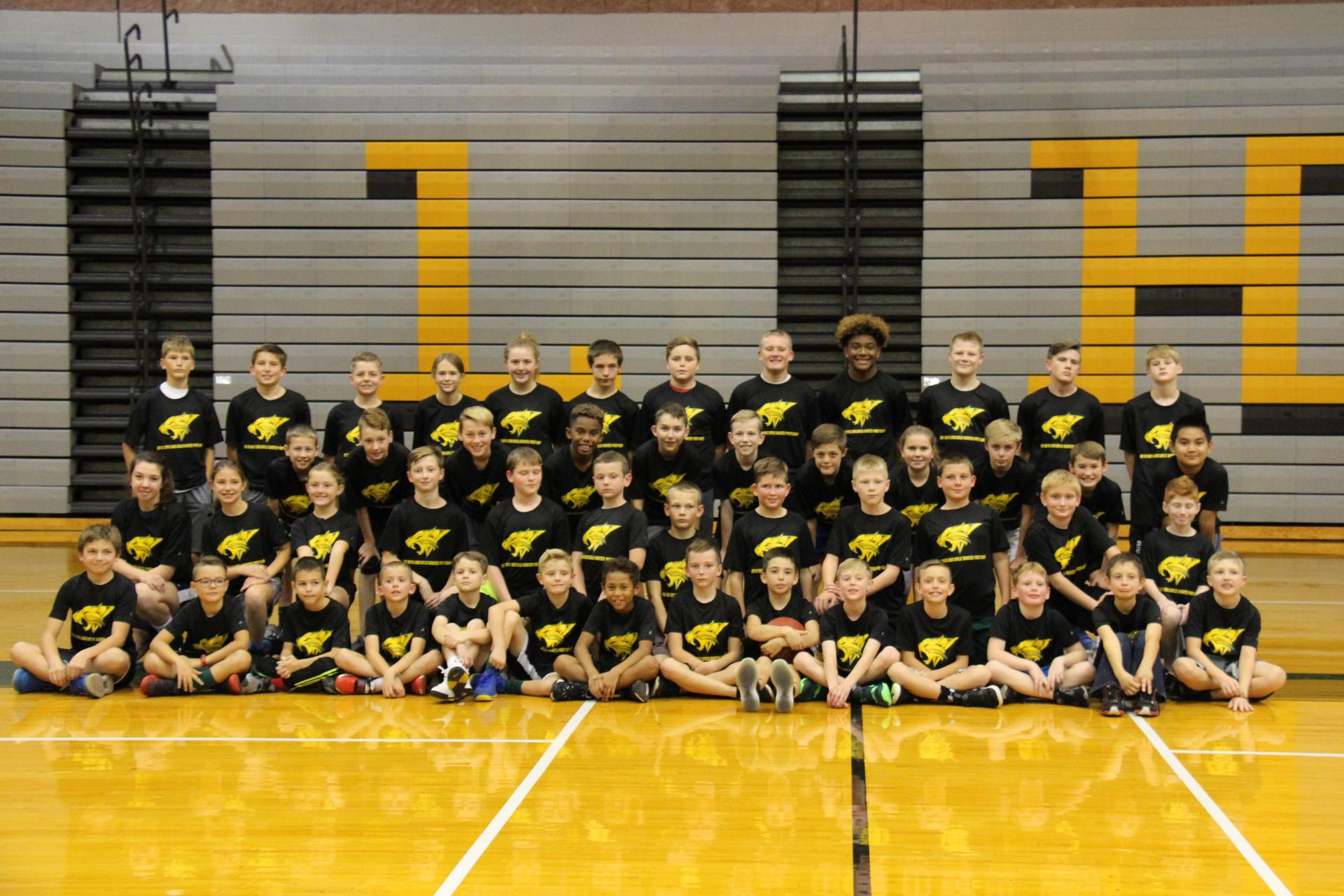 Students posing for basketball camp group picture