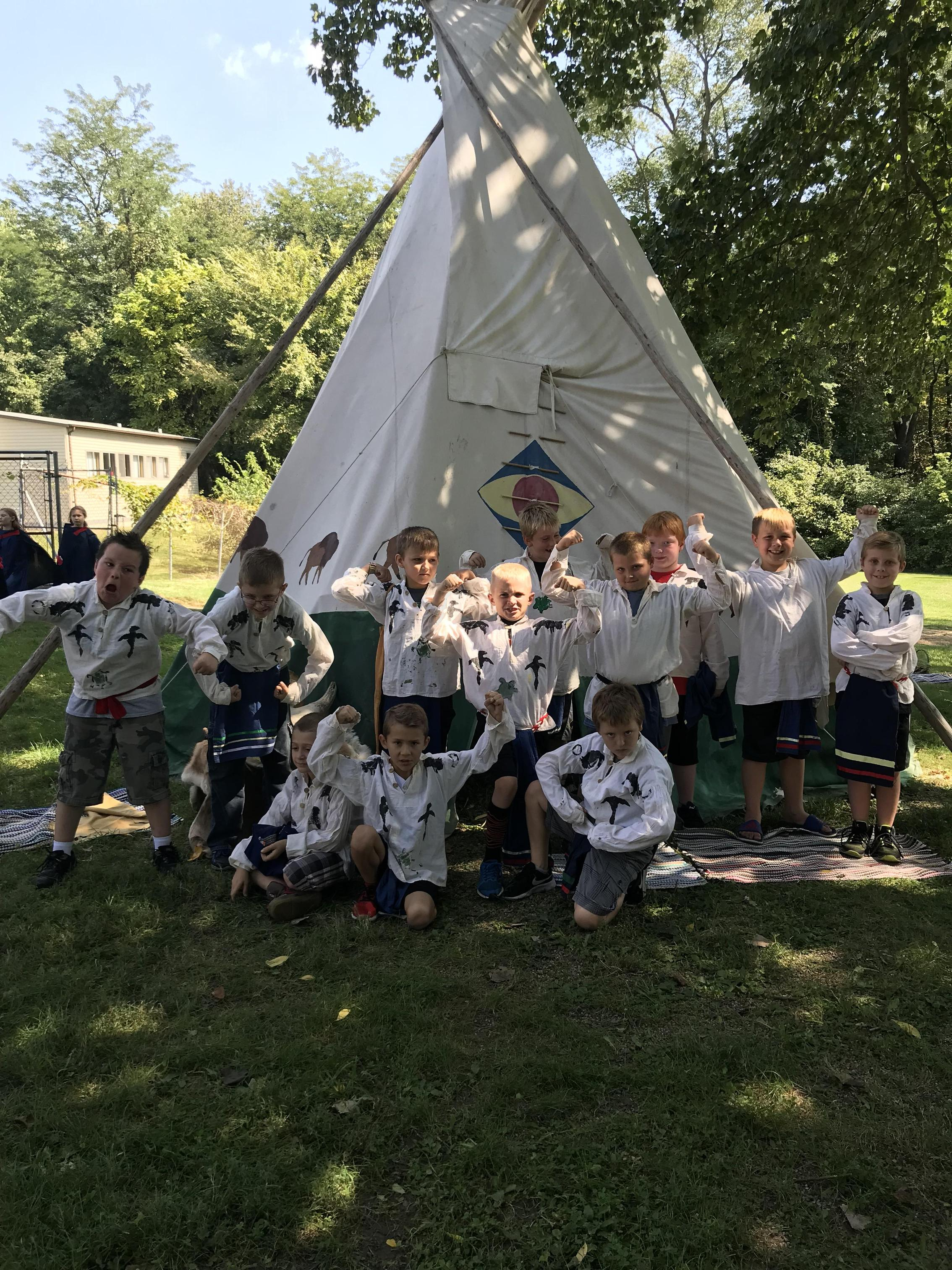 Students dressed as Pioneers in front of TiPi.