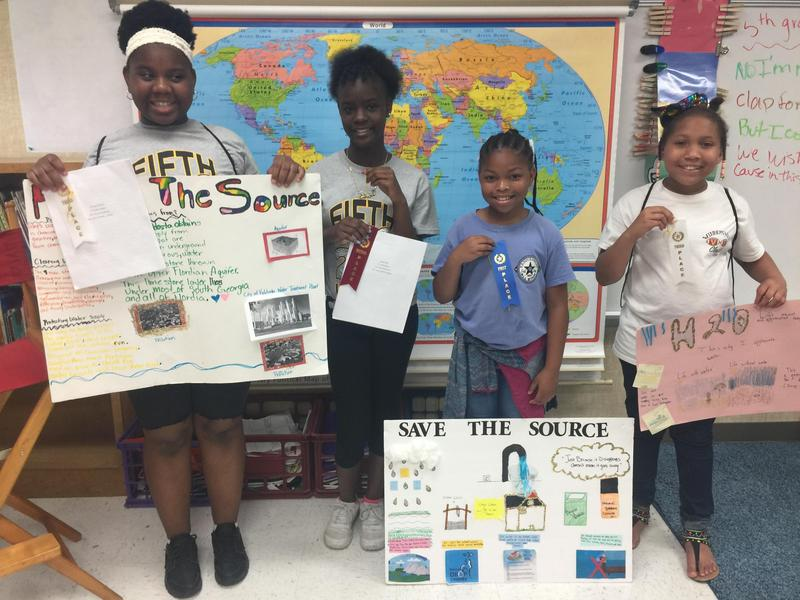 W.G. Nunn 5th grade students shown with City of Valdosta Mayor Pro Tem, Sandra Tooley, at the National Drinking Water Event. From left to right are 5th grade student, Angel Miller, Mayor Pro Tem, Sandra Tooley, 5th grade student, Rikyia Henderson, and 5th grade student, Za'Coya Thomas.