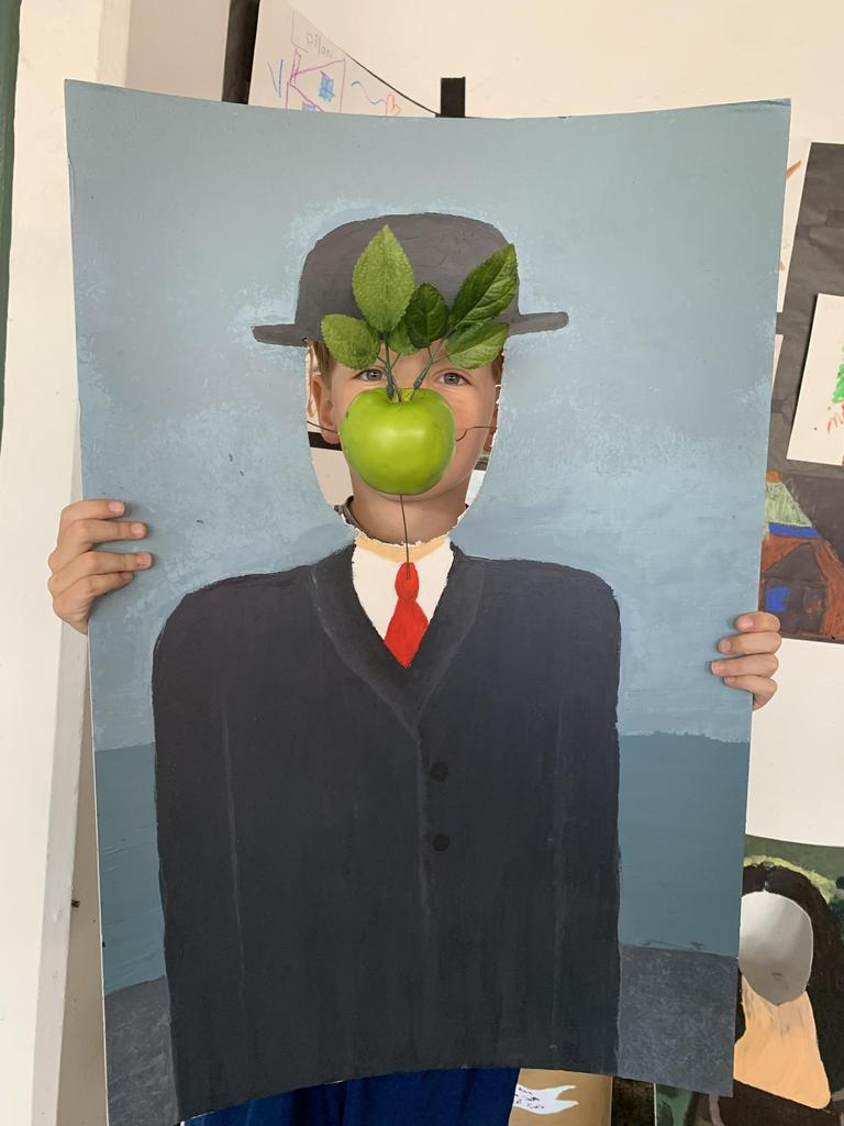 child posing in man with apple in his mouth painting