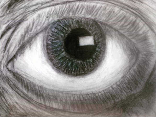 A fifth grade artist's realistic charcoal and pencil drawing of the human eye