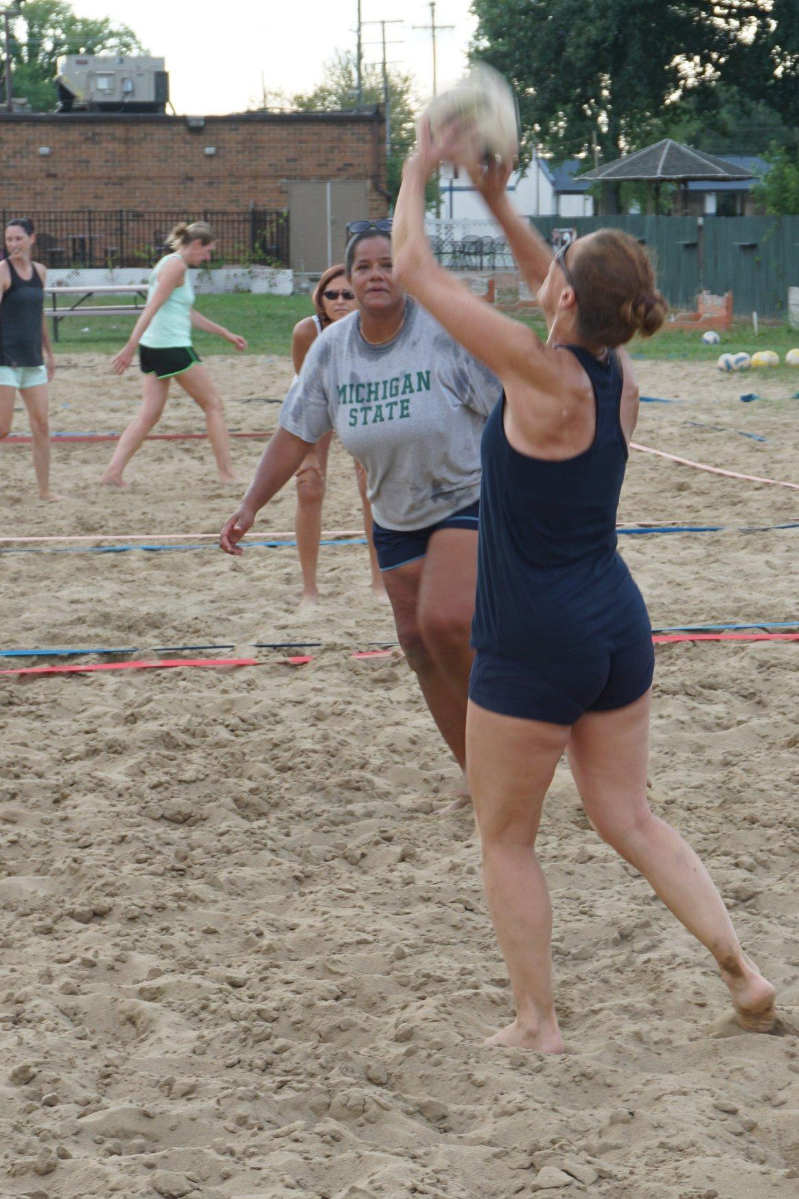 Sue playing volleyball