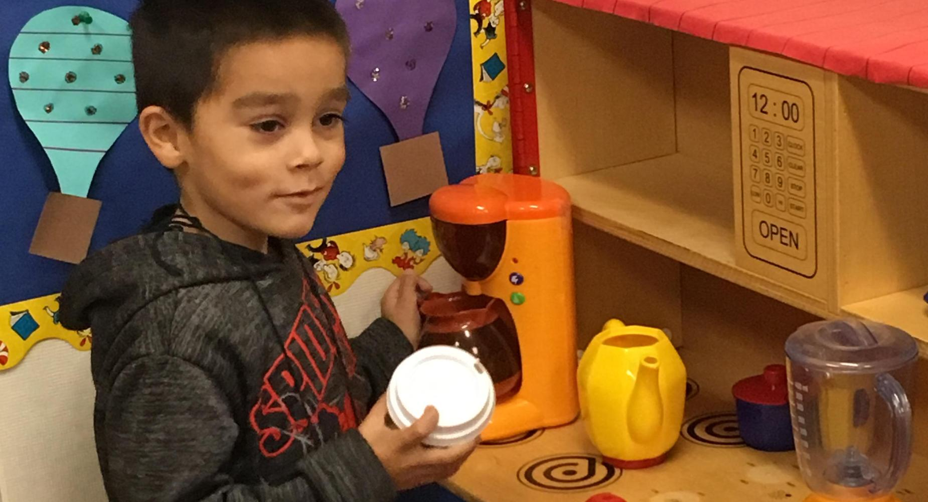 TK student making some coffee.