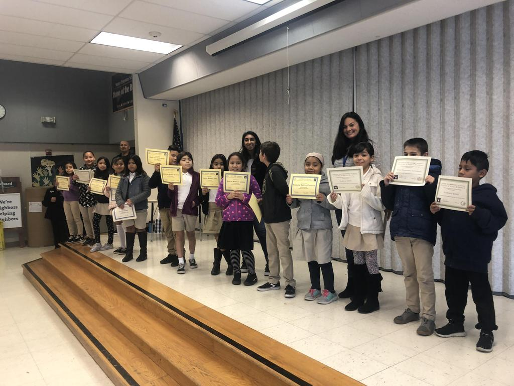 trimester one award winners in Ms. Yazdani's class pose for picture