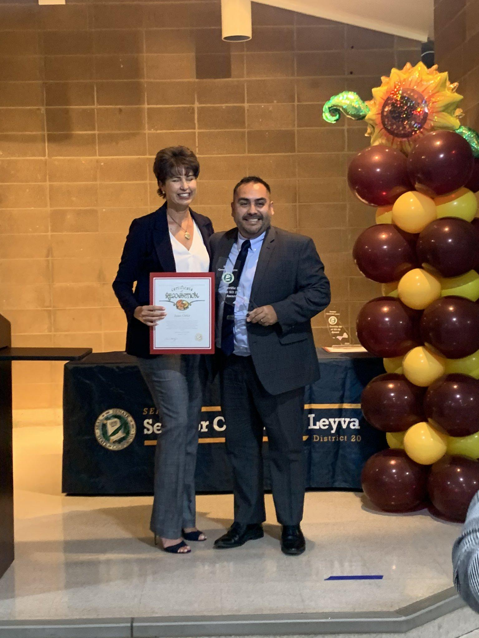 Pictured senator leyva and juan ortiz receiving certificate