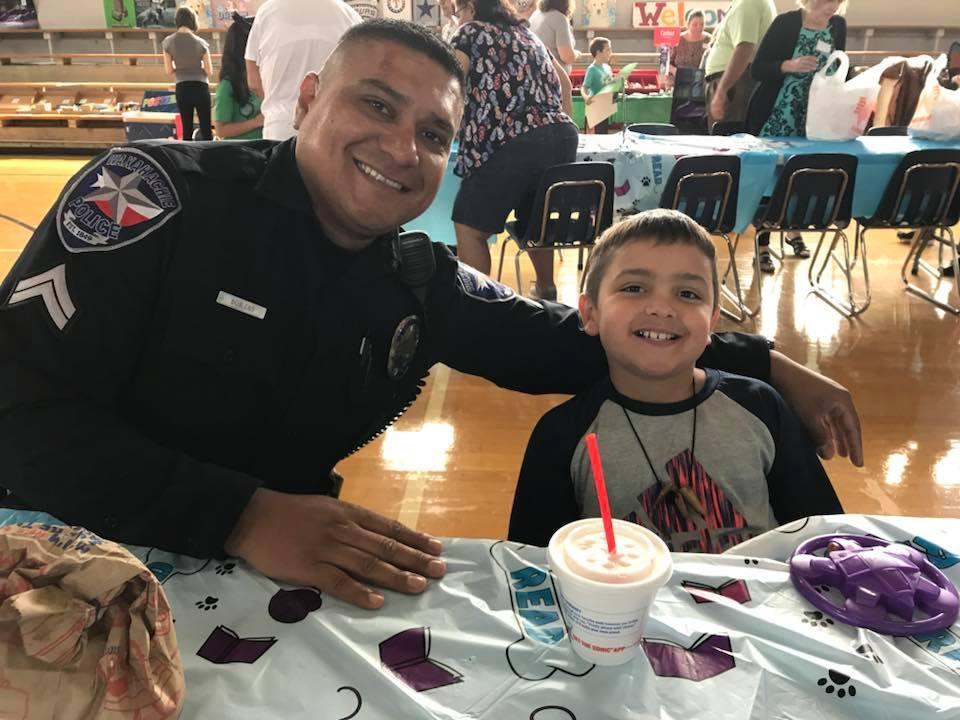 father in WPD uniform lunches with son