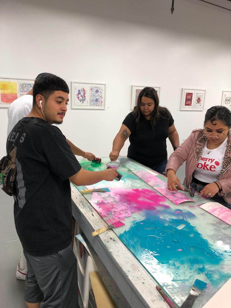 LA CAUSA students working on a project with Self Help Graphics