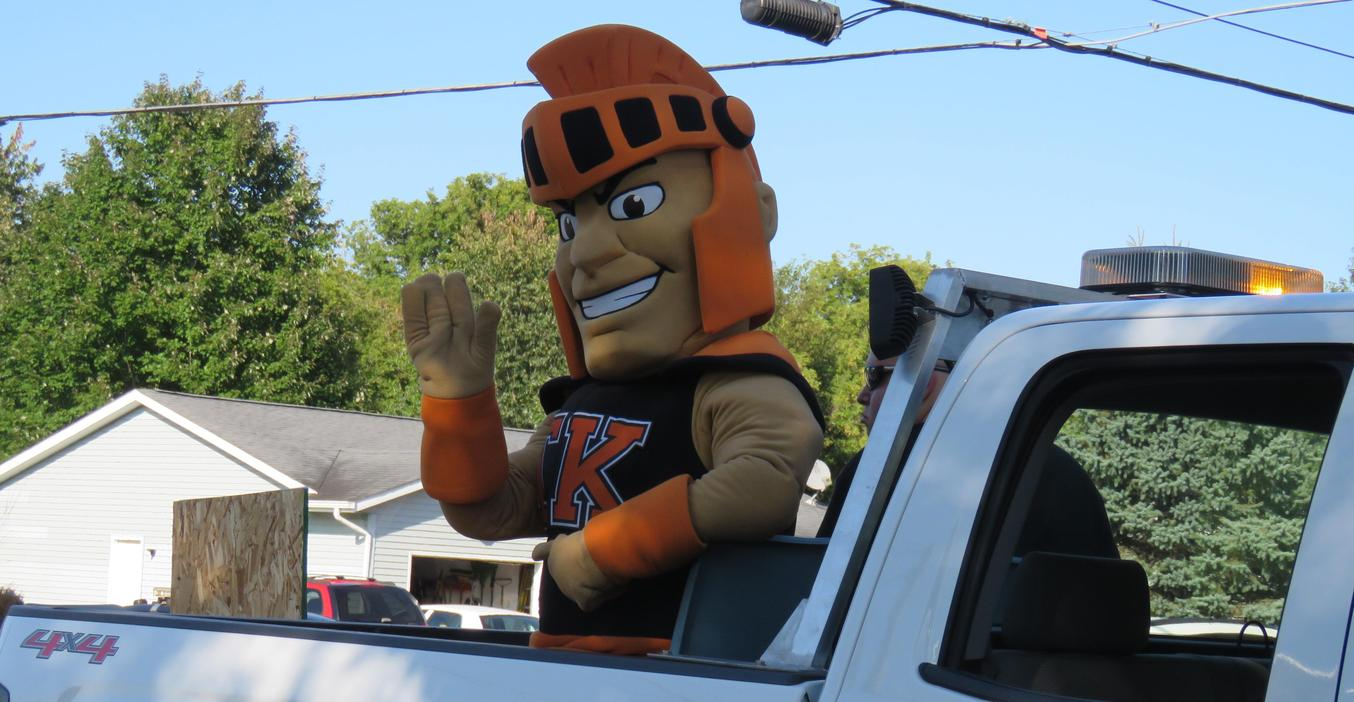 The TK Trojan mascot waves to the crowds at the homecoming parade.