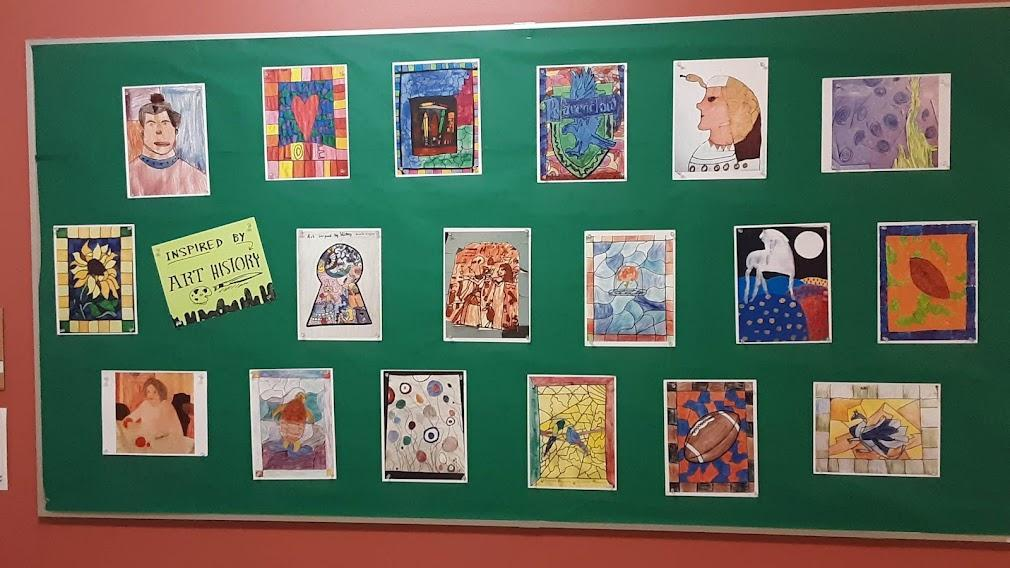 A board displaying artworks inspired by art history, grades K through 5