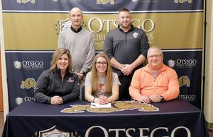 Alexis with her parents and coaches.