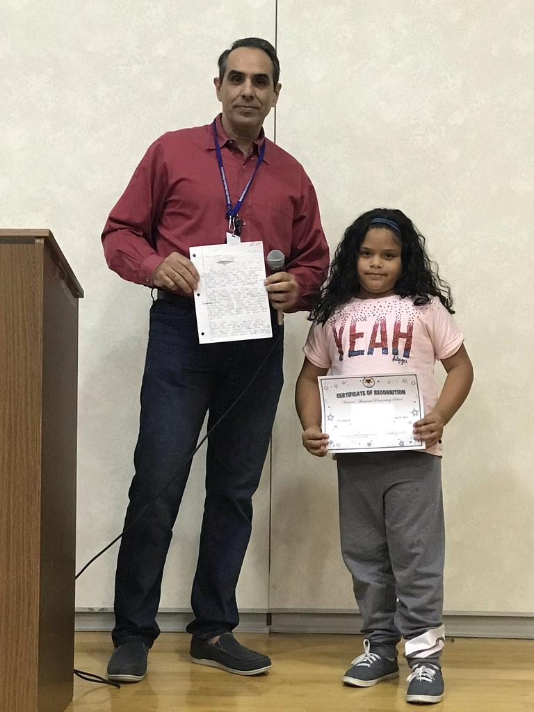a. lopez with vp calvo showing her winning essay and her certificate of accomplishment