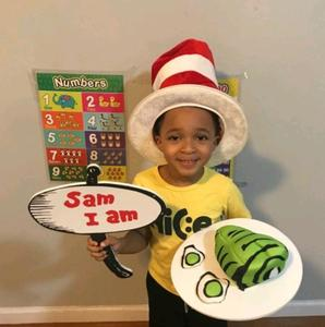 Boy holding green eggs and ham platter and