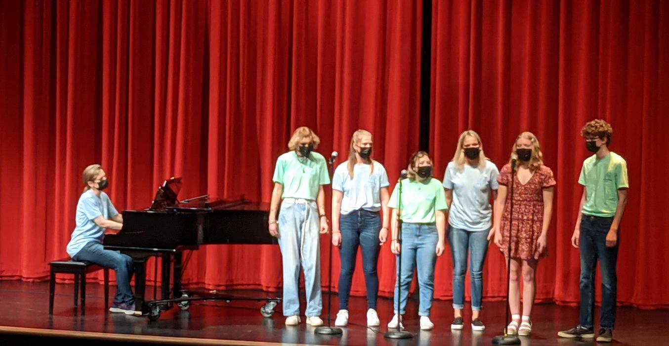 Choir students perform in a small group.