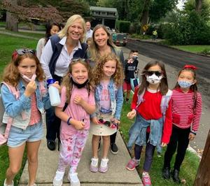 Wilson 2nd grader Zoey Edelstein (second from left) won the chance to walk to school with Mayor Shelley Brindle on Oct. 6, while inviting friends and family along for the annual tradition.