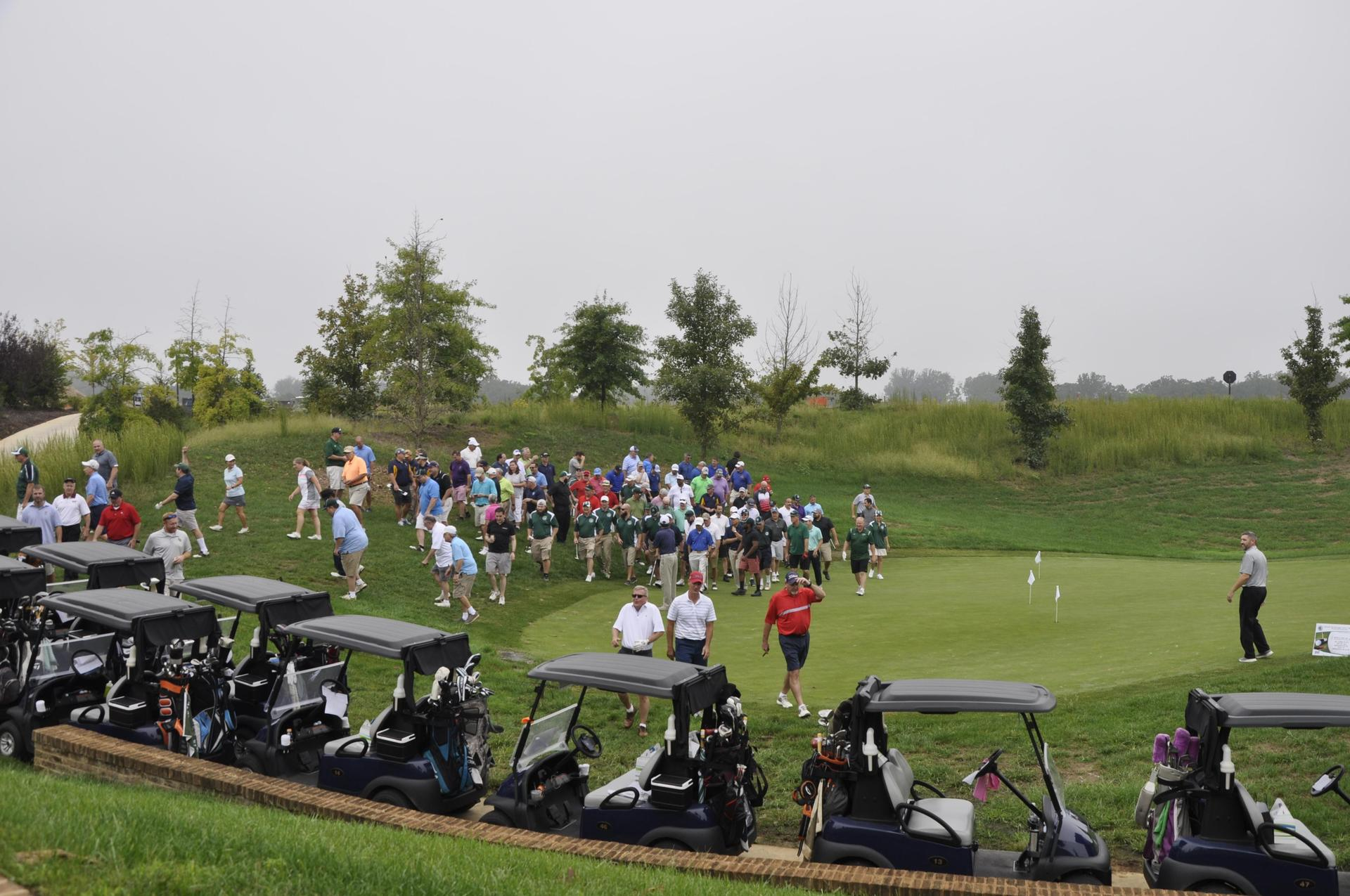 A view of golfers and golf carts