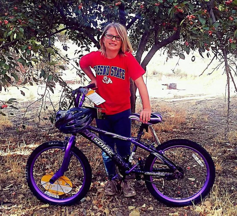 Perfect Attendance winner showing off her bike