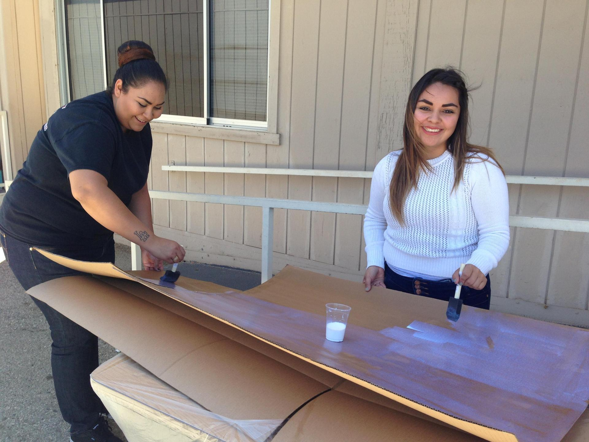 Palmdale students paint their cardboard boat