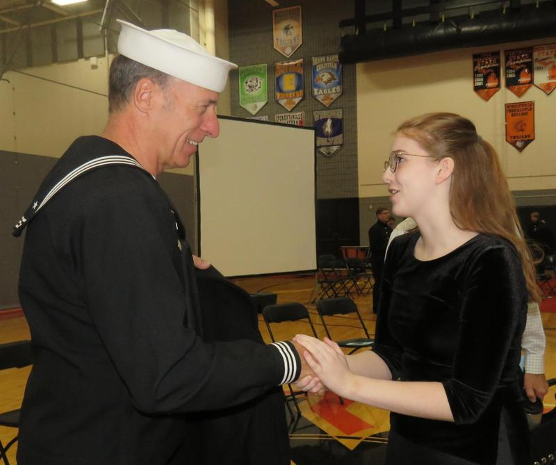A TKHS student thanks U.S. veteran Bob Buys for his service after the Veterans Day program at TKHS.