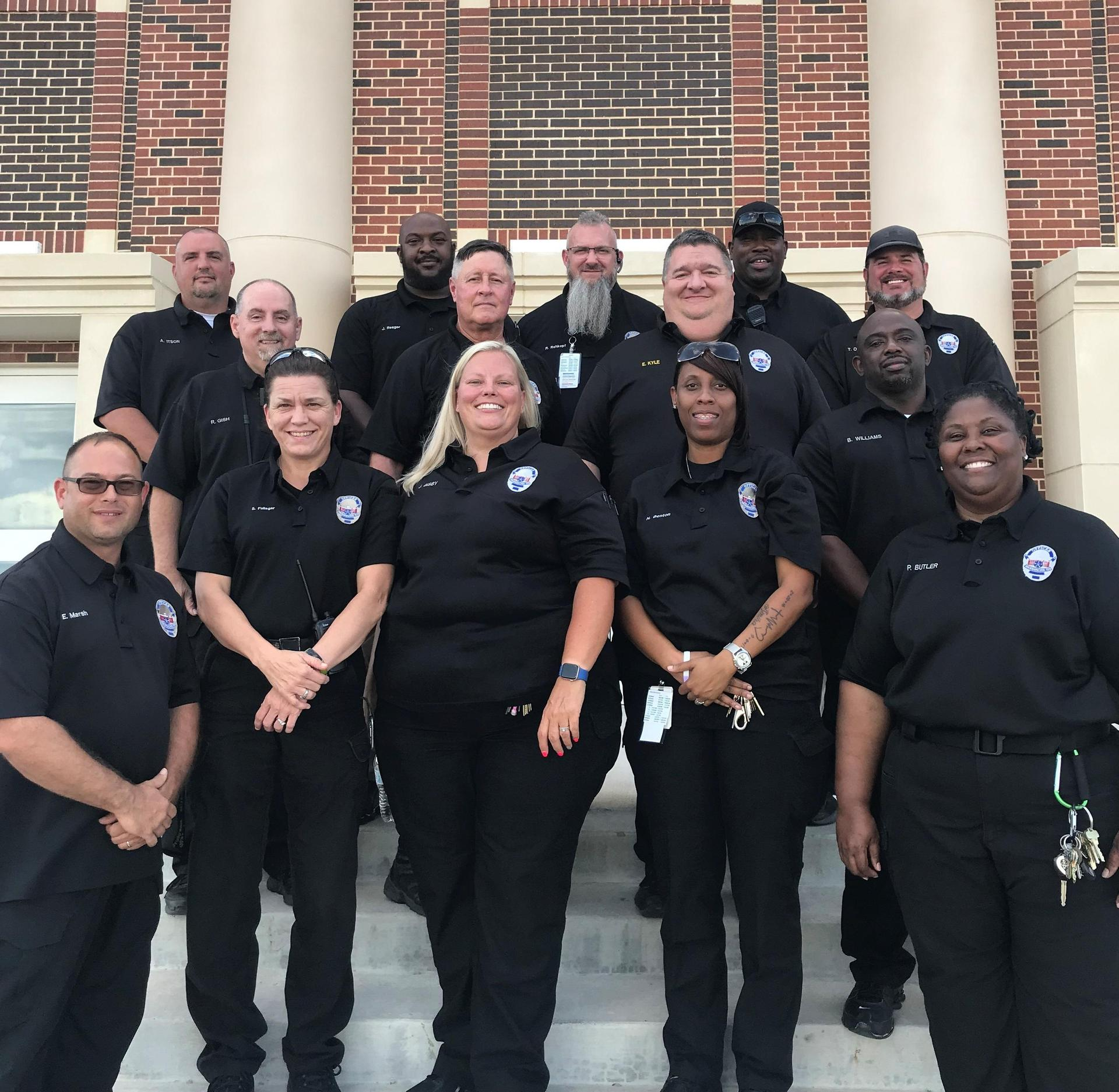 the security team posing outside an entrance to WHS