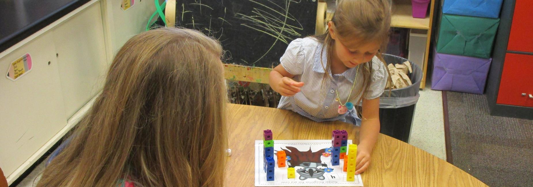 kindergarten working on counting blocks
