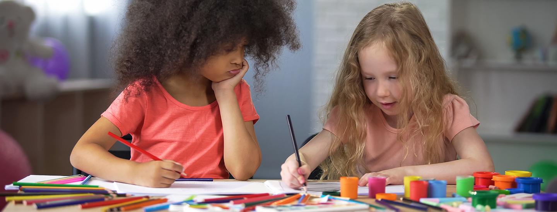 two girls writing