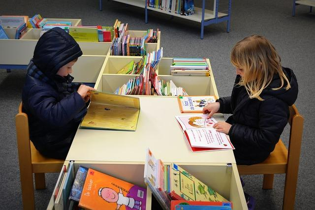 Children Reading at a Library Table