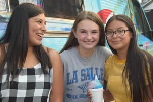three girls smiling at camera