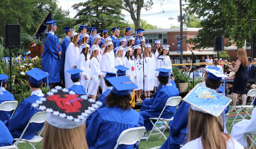 """Photo of WHS Class of 2021 Choir singing """"Unwritten"""" at commencement ceremony"""
