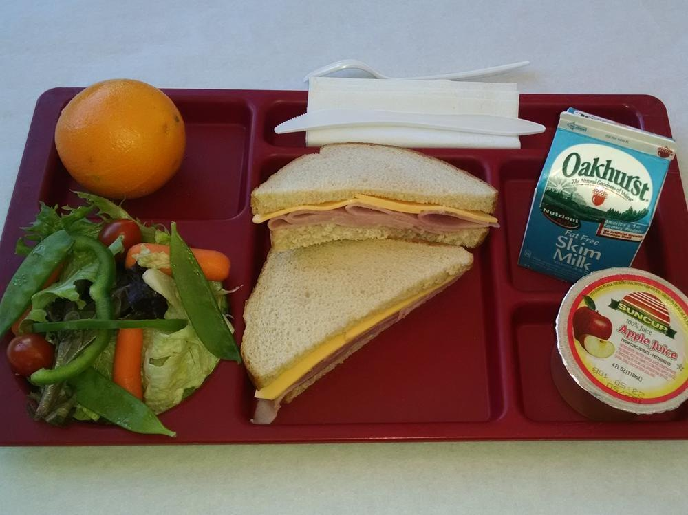 Ham & Cheese Sandwich, Salad, Orange, 100% Juice and Milk