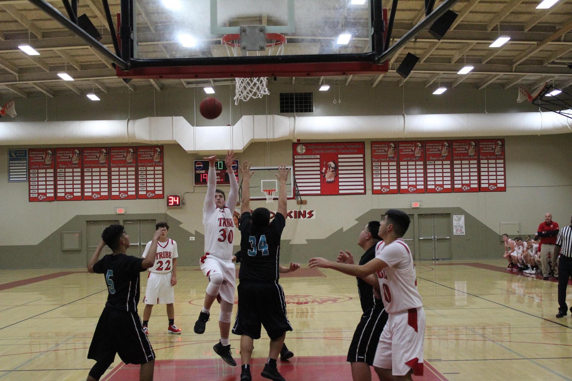 Junior Varsity boys playing basketball against Mendota