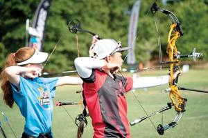 Liko Arreola (right) of Makawao competes during the JOAD National Target Championships last week in Raleigh, N.C. Arreola won the compound female bowman division. USA ARCHERY photo