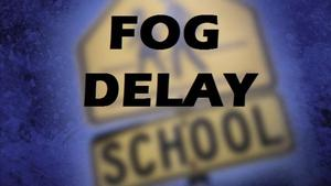 An image showing a school crossing sign with the words Fog Delay