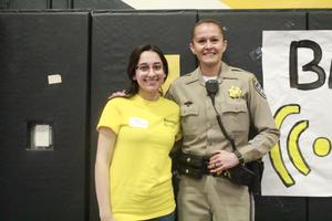 Student and California Highway Patrol Officer Smiling
