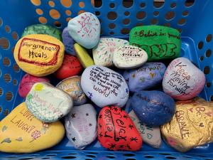 group of colored rocks with signs of kindness