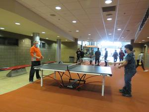 TKHS students and staff enjoy ping pong contests.