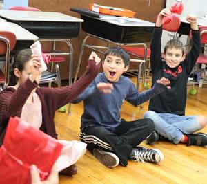 Photo of McKinley 5th graders sitting in a circle, playing a Valentine's Day game.