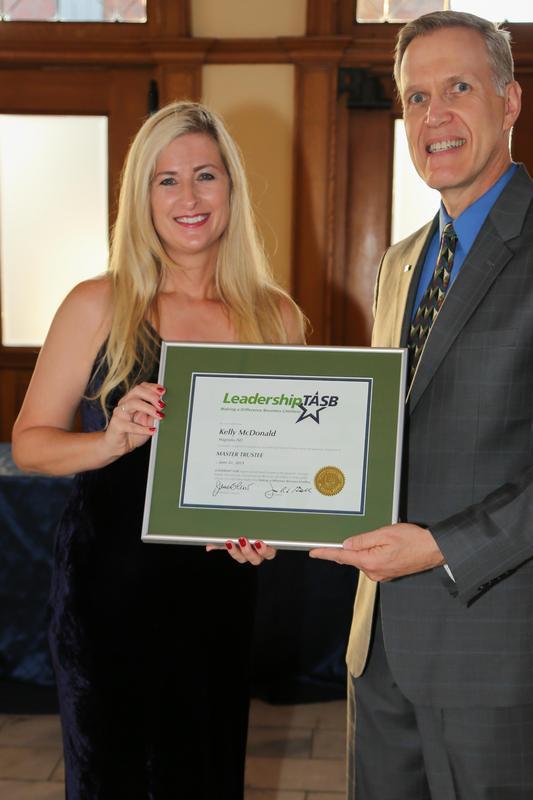 Kelly McDonald receiving the TASB certificate