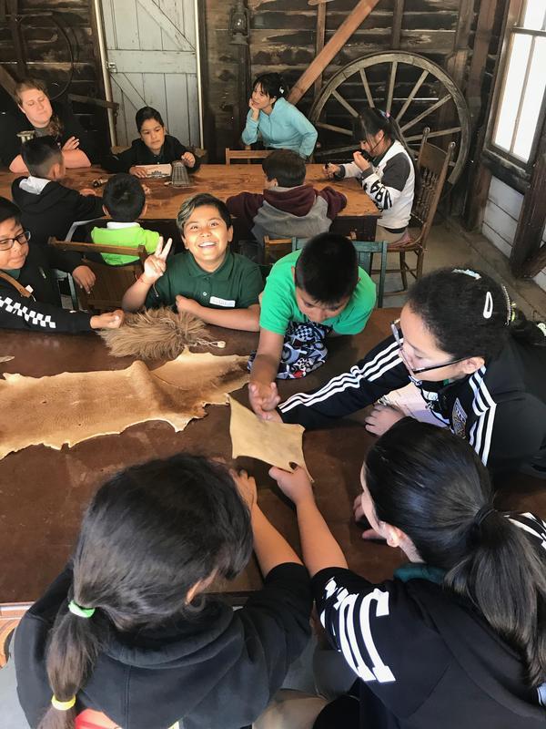 students feeling animal pelts