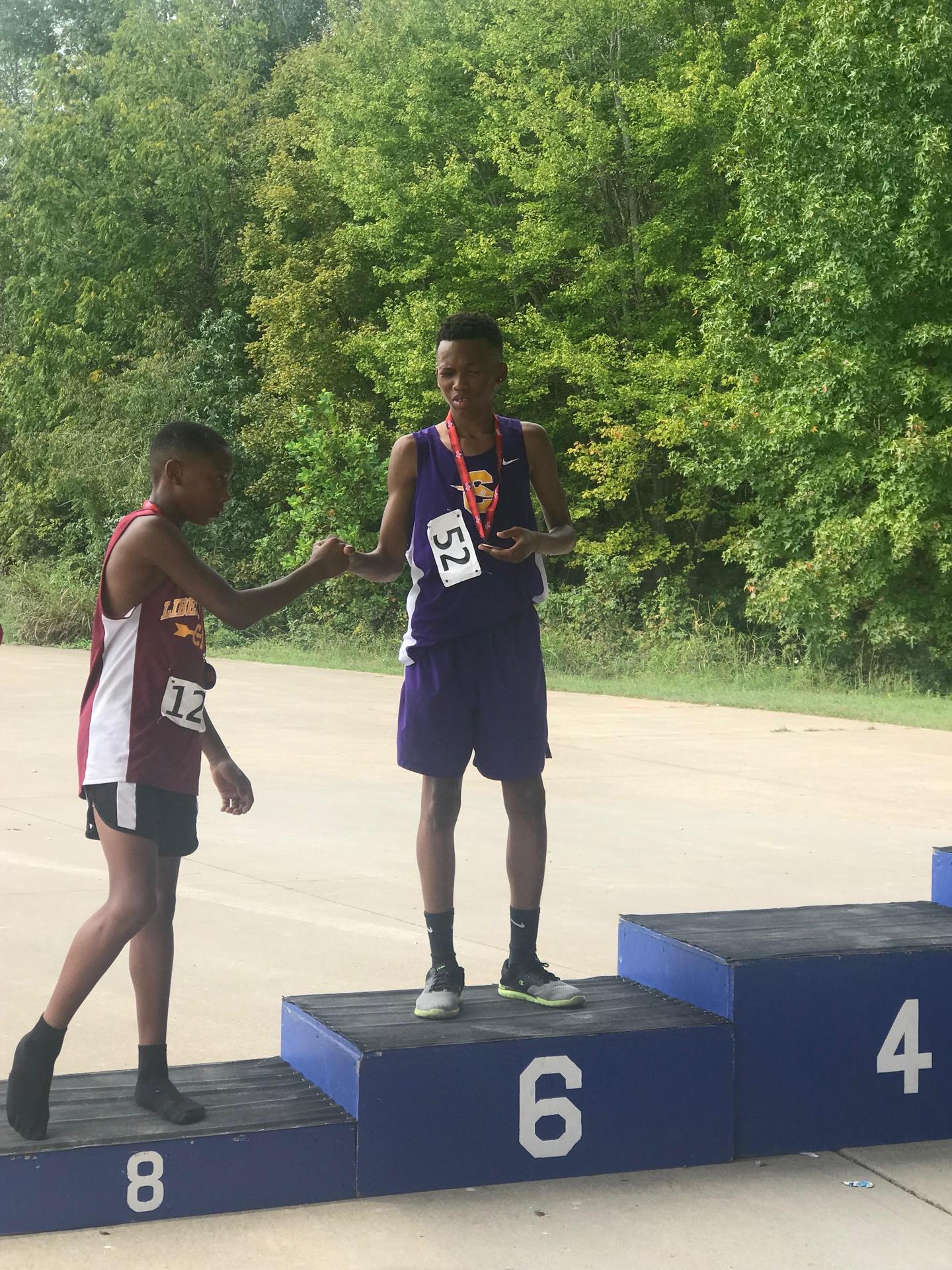Cross Country's athlete S. Coleman showing great sportsmanship and congratulated another school player for placing in a competition.