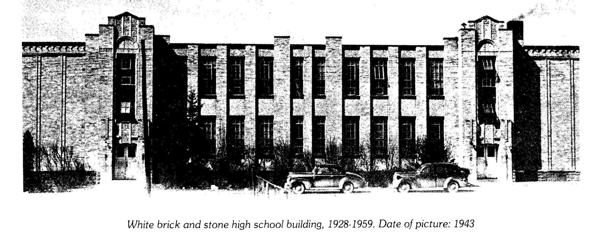 Black and white photo of White brick and stone high school building, 1928-1959 Date of picture: 1943