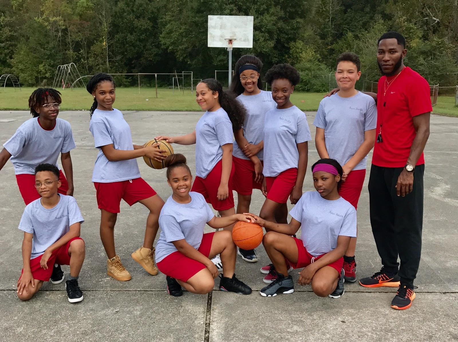 Photo of some Park Ridge Middle School students and their P E teacher in their new gym uniforms