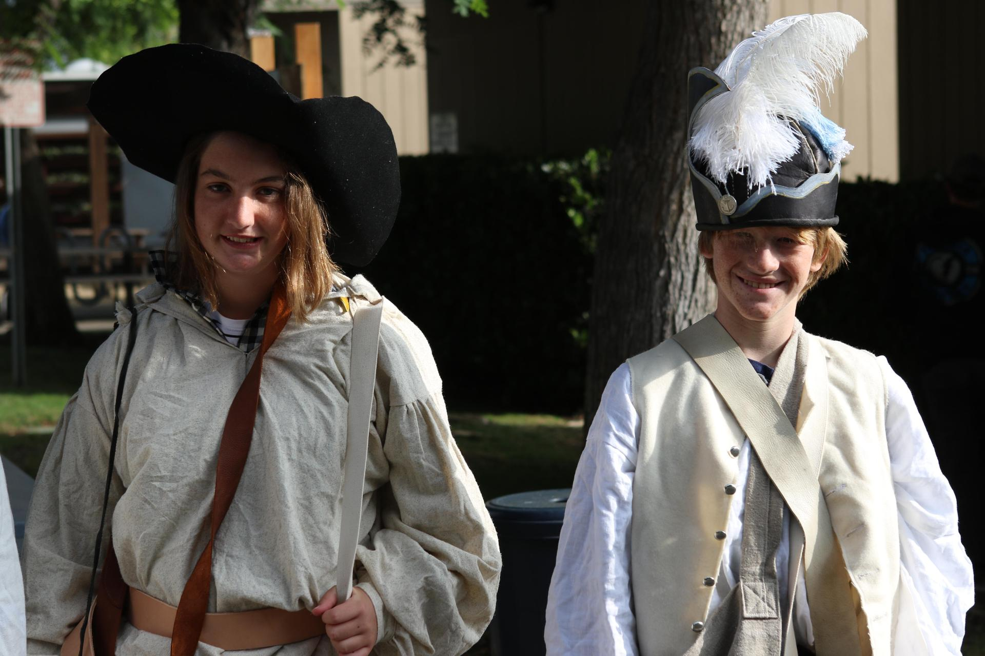 Middle school students wearing authentic colonial clothing.