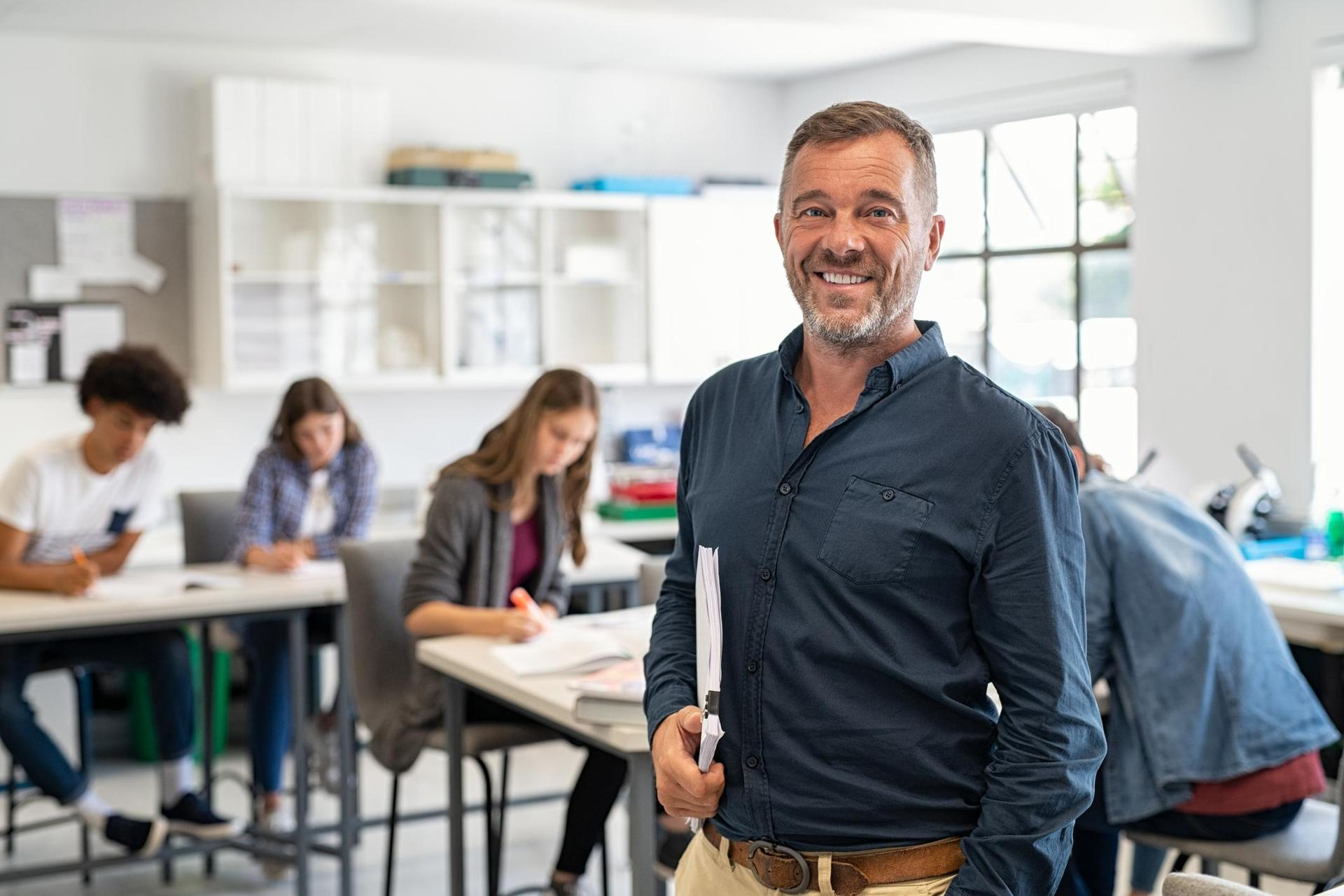 Male high school teacher looking at camera